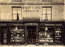 The Barnet High Street shop front of J. Cowing, publishers of the Barnet Press, as it was in July 1913