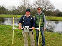 Dominic Barker, of the University of Southampton, at work with his magnetometer in Wrotham Park. Sam Wilson (right) is the archaeologist leading the Battle of Barnet survey and excavation.