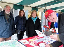 Roger Aitken signing the petition at the Christmas Fair with Robin Bishop, Mary Carroll and Teresa Kelly