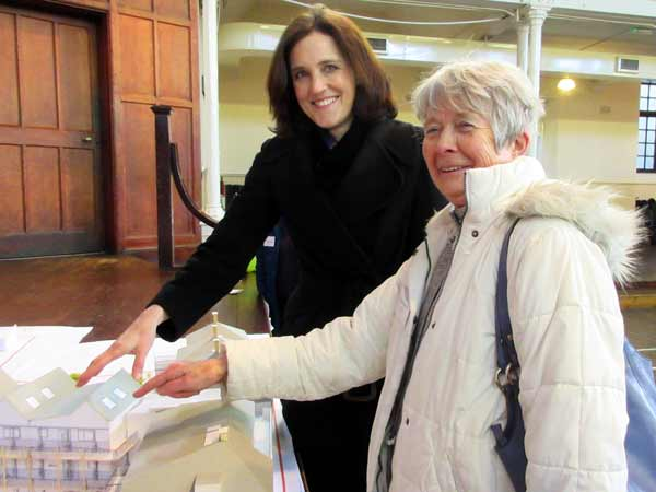 Angela Ratcliffe, shows Chipping Barnet MP Theresa Villiers the flat she hopes to occupy