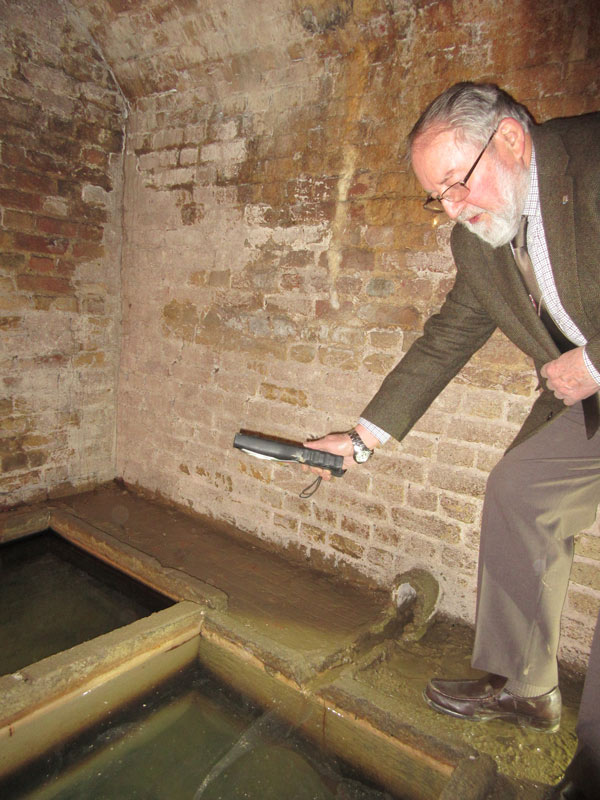 Mike Jordan, chair of Barnet Museum's trustees, showed visitors the two tanks of spring water inside Barnet's historic physic well