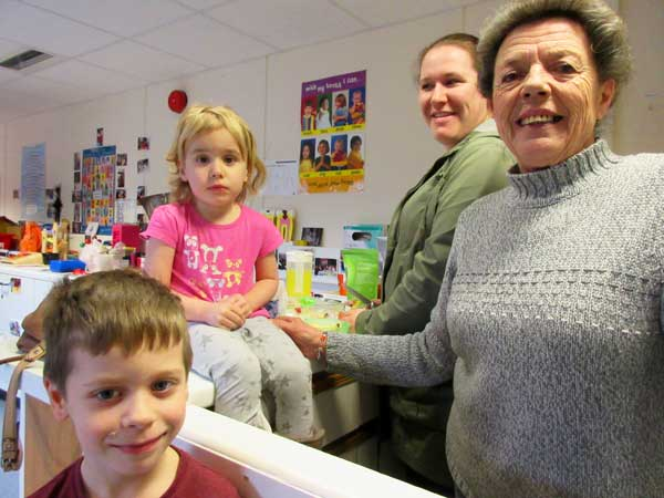 Smiles for the camera at the Valley Pre-School's open day. L to R: Luke, Erim and their mother Mrs Sarah Mulvihill and Mrs Wendy Oliver, the longest serving member of staff