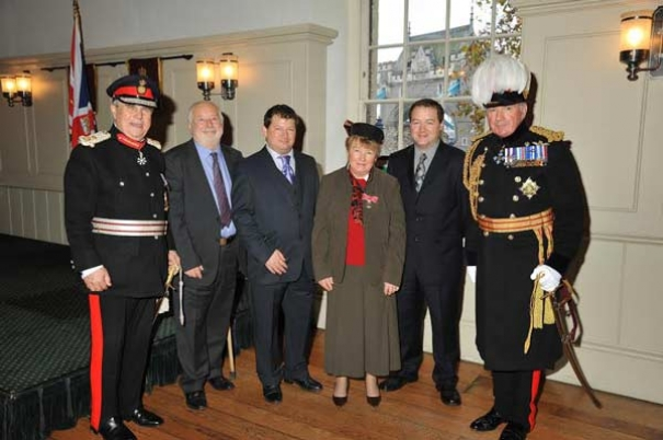 Dr Gillian Gear invested with the Order of the British Empire at the Tower of London in Nov 2014.  L to R: Sir David Brewer, Lord Lieutenant of Greater London; Michael Gear (husband); Tim Gear (son); Gillian Gear; Chris Gear (son); General Lord Dannatt, Constable of the Tower