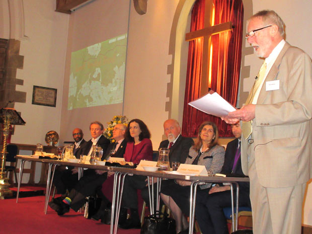 Robin Bishop welcoming the panel to the Barnet Society's spring forum, Barnet Beyond Brexit.  From left to right, Cali Ibrahim, Councillor Ross Houston, Richard Knox-Johnston, Theresa Villiers, MP, Bob Burstow, Violet Walker and Chris Fairbairn