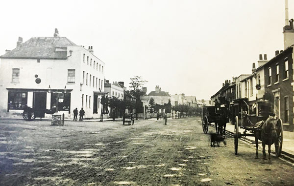 Peter Wanders' shop is to the right of the pony and trap. This is mid-1880s, before the Corn Exchange, at the corner of High Street and St Albans Road was rebuilt in 1891