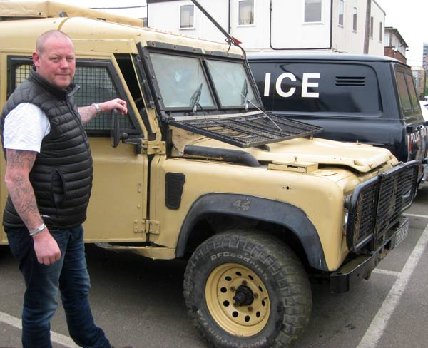 "Ben Dillon beside one of three ""snatch"" vehicles supplied for filming the Cormoran Strike. In the background is a Ford Transit Mark 1 Police van that featured in the latest Morse drama, Endeavour"