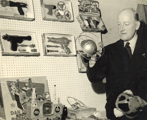 Eric Lucas at a trade exhibition between 1950 and 1965