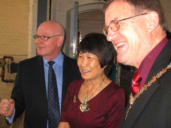 David Parry, chairman of the trustees, with the Mayor of Barnet, Councillor Hugh Rayner, and his wife Susan, examining progress on the reconstruction of the interior