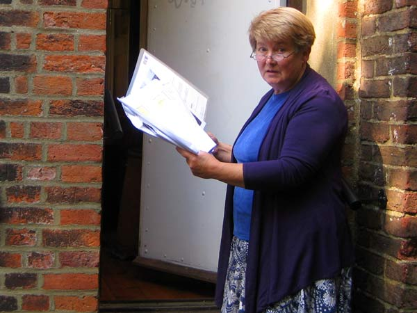 Dr Gillian Gear, archivist, examines the plans for a three-storey extension