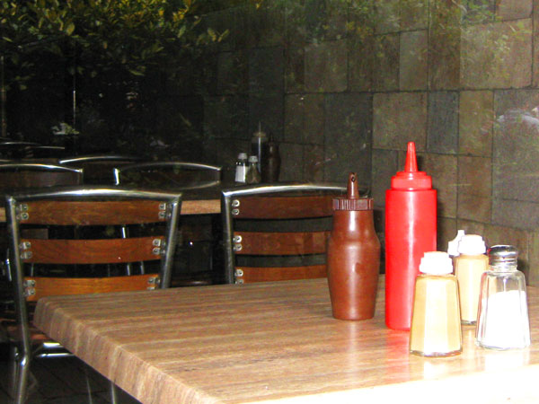 Salt and sauce bottles still on tables