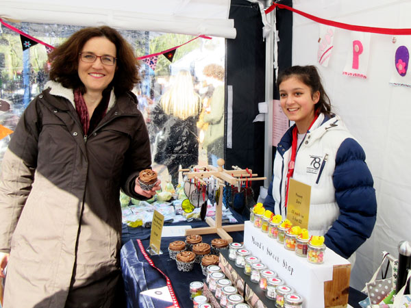 Theresa Villiers MP at the stall of Maud Quinton