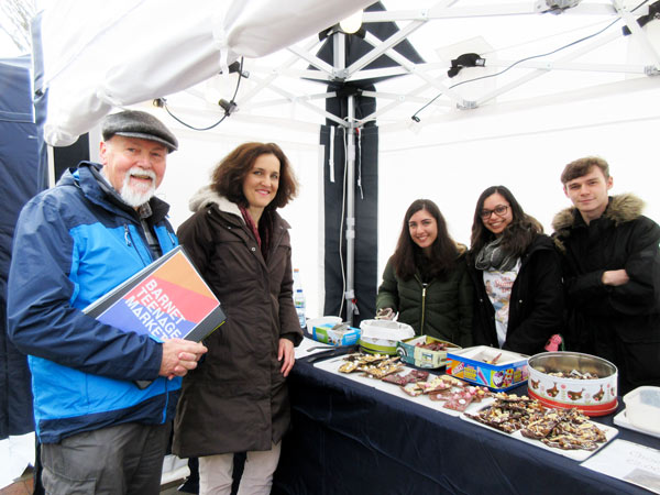 Bob Burstow, organiser of the teenage market, and Theresa Villiers MP, with Rosita Bagherzadeh, Georgia Dias and Nathan Lang selling home-made chocolates and sweets