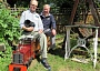Ian Johnson (right) astride the trailer of his electric engine, on his miniature railway line at his home in Wood Street, Barnet. With him at the controls is Derek Smith, a fellow member of the North London Society of Model Engineers