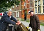 Derek Epstein (left) of the Barnet Society and Gordon Massey, chairman of the Barnet Residents Association, hard at work washing clean the Church Passage bench.