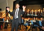 Music teacher Paul Nathan conducing QE Girls' school orchestra and choir