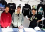Queen Elizabeth's Boys' School pupils Kai Sethna (centre) and Hugh Westcott (right) have launched a business selling designer street wear. Helping them man their stall was Thomas Mgbor