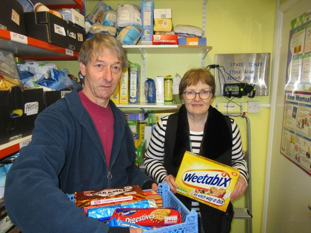 Chipping Barnet foodbank volunteers Harold Williams and Monica Phelps prepare food items ready for distribution