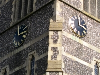 The new gold leaf on the Roman numerals shining bright in the autumn sunshine