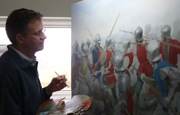 Medieval artist Graham Turner at work on his oil painting of the Battle of Barnet