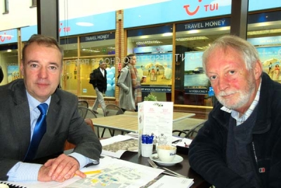 Steve Mellor (left), head of planning for Shanly Homes, briefs Robin Bishop, chair of the Barnet Society, on the company's plans for the Brake Shear House site off Barnet High Street.