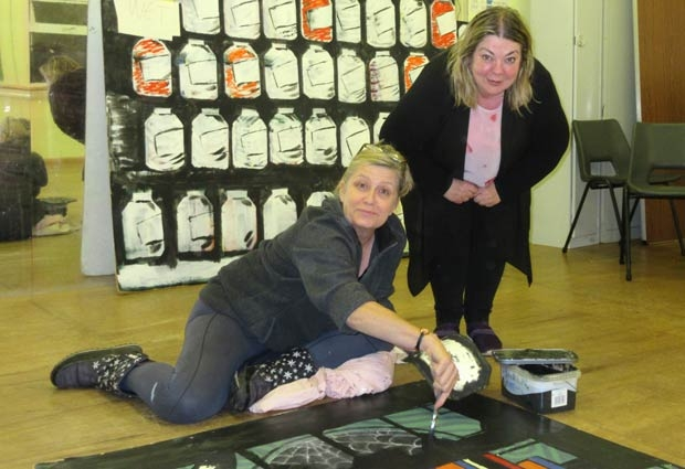 Nichola Hunt  painting scenery for Dick Whittington at the Bull Theatre with Suzi Earnshaw