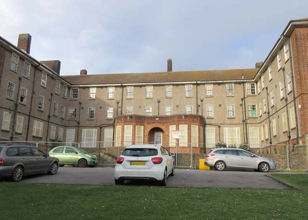 Barnet Hospital's former nurses' home is currently protected by scaffolding and barriers due to its dilapidated state