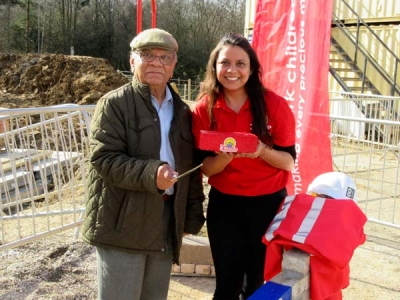 Champak Mistry of Barnet Rotary Club (left) preparing to lay a foundation stone with Punyapriya Singh, Noah's Ark's senior community engagement manager