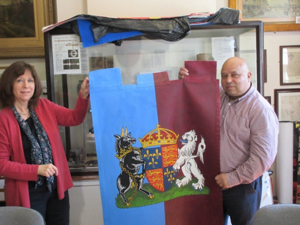 Hilary Harrison, a member of the Battle of Barnet project team, and Barnet Museum trustee Michael Noronha, with the newly-painted Henry VI banner