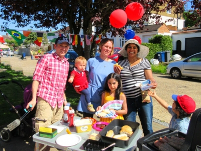 Enjoying the barbecue at the Old Fold View royal wedding street party were, (from left to right), cook Matt Fellows, one of the organisers, Angela Spatz with baby Grace, and neighbour Anushka Pisano