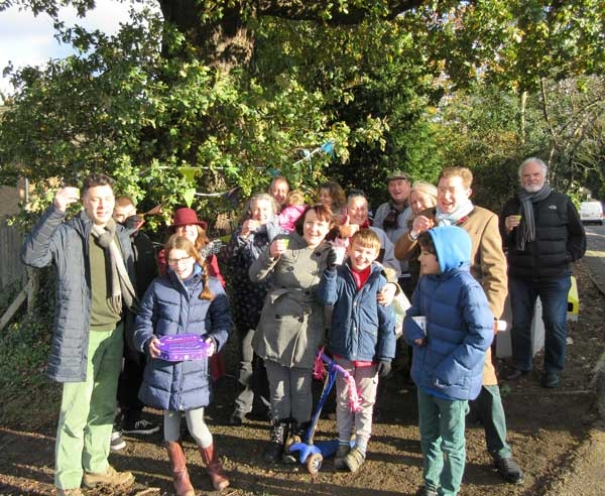 "Simon Cohen (far left) and local residents raise a cheer for the mighty oak at the junction of The Meadway and Potters Road. The celebration was in support of the Woodland Trust's ""We Love Street Trees"" campaign."
