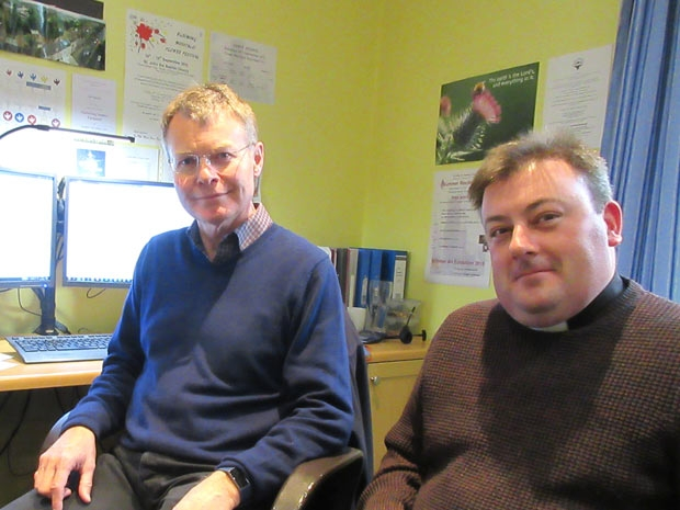 Parish administrator Tony Long (left) with the rector, Father Chris Ferris, in their office in Church House