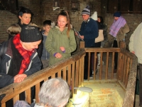 Visitors queuing to descend the original steps to see the tanks of mineral spring water