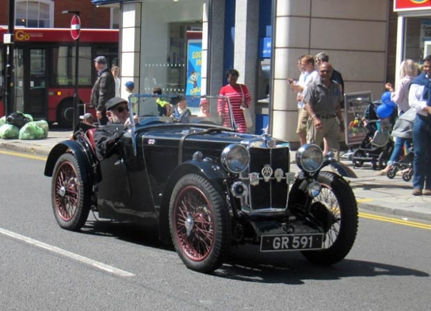 Mike Jordan's 1930s MG J2 parading in Barnet High Street