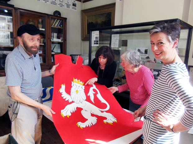 A rampant lion is the centrepiece of Sir John Marney's heraldic banner, one of 70 to be displayed this summer in Barnet High Street. From left to right, Geoffrey Wheeler, historian and photographer, who researched Wars of the Roses coats of arms, Hilary Harrison, who co-ordinated the painting, and volunteers Irene Nichols and Gwyneth Hibbett