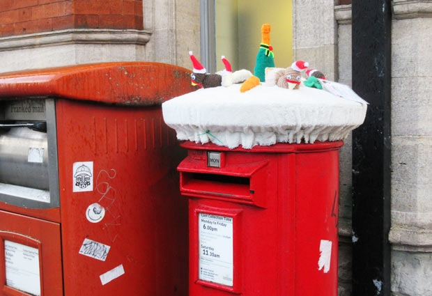 Post box on Barnet High Street decorated with knitted animals