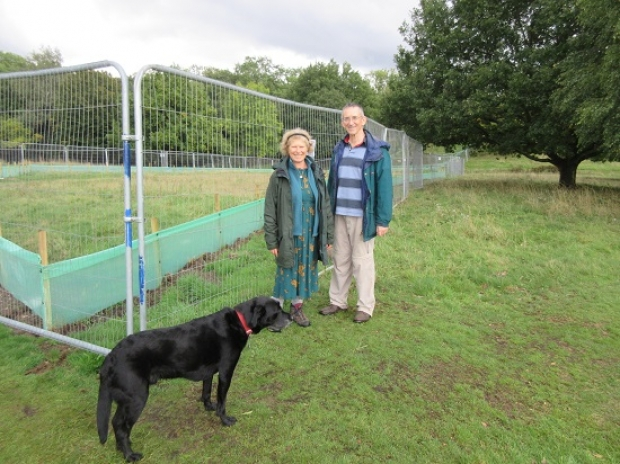 Michael and Karen Hallowell -- and their dog Monty -- check out the protection for great crested newts