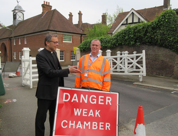 Dr Thomas Renz, rector of St Mary's Monken Hadley, is shown the site of the 33ft deep shaft that will have to be dug beside the historic gates – a task that project manager Mark Lusher says presents considerable challenges given the number of historic and listed buildings nearby