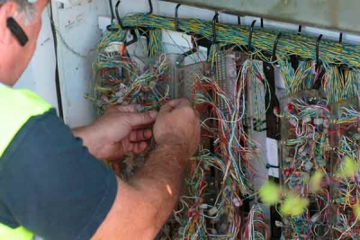 BT engineer installing new Broadband cabinet