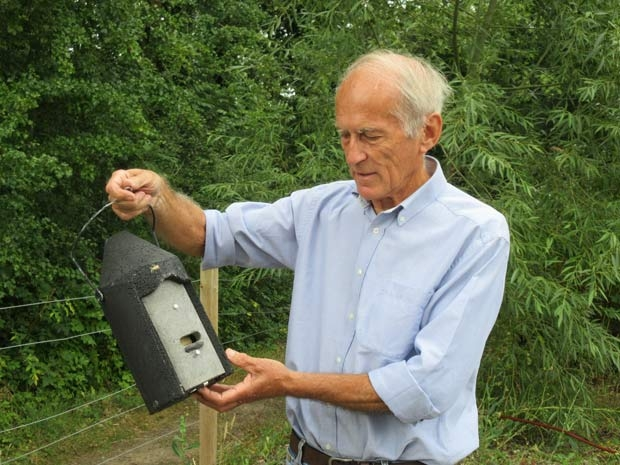 Dick Elms, vice chair of Barnet Environment Centre, with one of the bat boxes to be installed on the Byng Road nature reserve