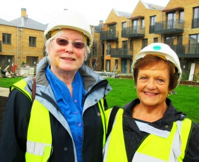 Maria Brenton, consultant to the Union Street co-housing project, with new resident Janet Wood.