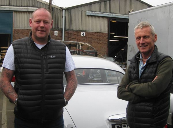 Ben Dillon (left) and Mark Raggett, art director for The Crown series being produced at Elstree Film Studios,  standing beside a Jaguar Mark 1 featured during a scene when the Queen visits the Jaguar car factory