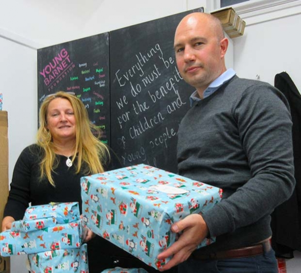 Presents are piling up ready to be wrapped and distributed by the team at Young Barnet Foundation headed by Janet Matthewison, chief executive, and Peter Williamson, operations manager