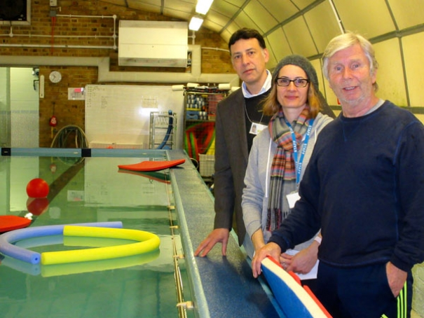 Jim Collis (far right), has helped to teach over 2,000 children to swim in his 20 years at the school. With him are swimming supervisor Josie Snowdon and parent Simon Cohen who is helping with fund raising