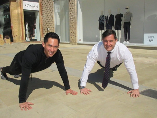 Limbering up for their world record attempt at an endurance press up relay race, Sonny Reneti (left), supermarket assistant at Waitrose, and Shaun Wall, Spires shopping centre manager