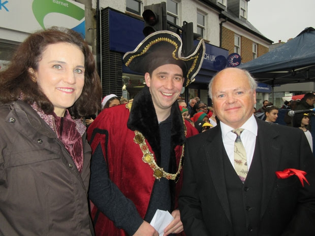 "The official line-up at the opening of Barnet's Christmas Fayre – Theresa Villiers, MP for Chipping Barnet, the ""Lord Mayor of London, Richard Whittington"" (David West) and fellow actor, High Barnet Councillor David Longstaff, who is the pantomime dame in Dick Whittington at The Bull Theatre."
