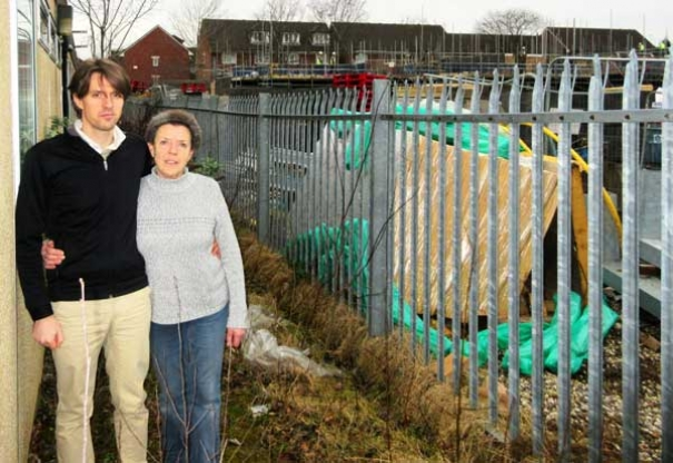 Mark and Wendy Oliver beside the temporary classrooms of Valley Pre-School