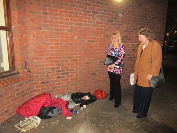 Councillors Lisa Rutter (left) and Alison Cornelius examining a sleeping area of one of the rough sleepers outside Chipping Barnet Library