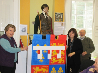 One of the banners painted by volunteers at Barnet Museum (from left to right) Margaret Luck, Hilary Harrison and Mike Jordan, chairman of the museum's trustees