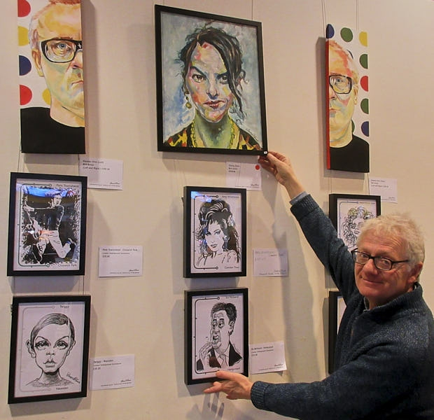 Paintings, caricatures and cartoons by Simon Ellinas on display at the Reel cinema, Boreham Wood
