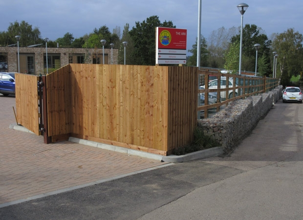 The wall built over a pedestrian  walkway to the Byng Road environment centre, playing fields and allotments